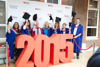 Successful MSc and Postgraduate Diploma students from The Berne Institute, pictured at Middlesex University graduation ceremony, July 2015